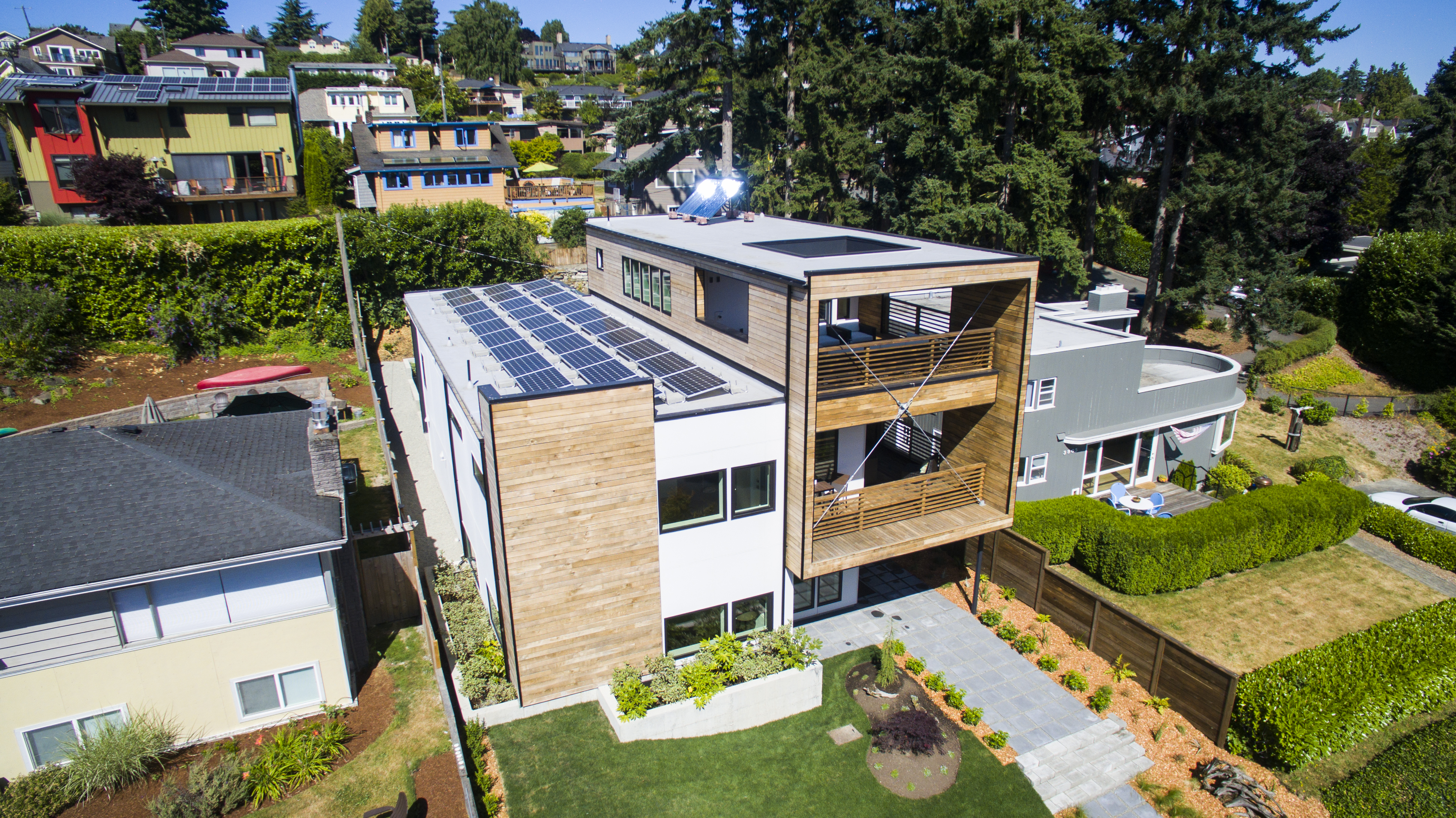 Dwell Development in Seattle won the top Housing Innovation Award in the Spec home category for a 3-story, 3700 square foot net zero energy home on Lake Washington. The company builds one-of-a-kind net-zero homes designed and detailed to compete with code-built homes.